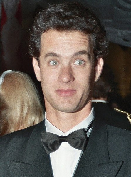 Tom Hanks in 1989, with a surprised look on his face. Photo by Alan Light