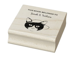 This book belongs to personalized name book rubber stamp, with a cool nerdy cat with a baseball hat