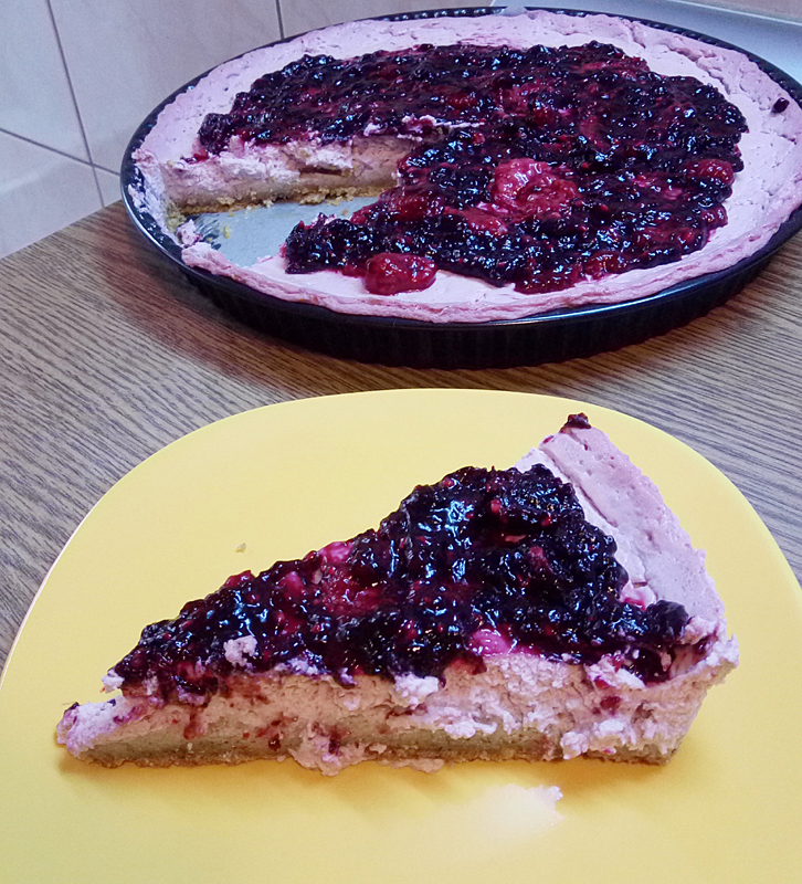 Gluten-free, sugar-free, egg-free raspberry cheesecake with forest fruit topping