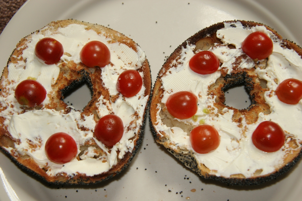 Bagel with cream cheese and cherry tomatoes