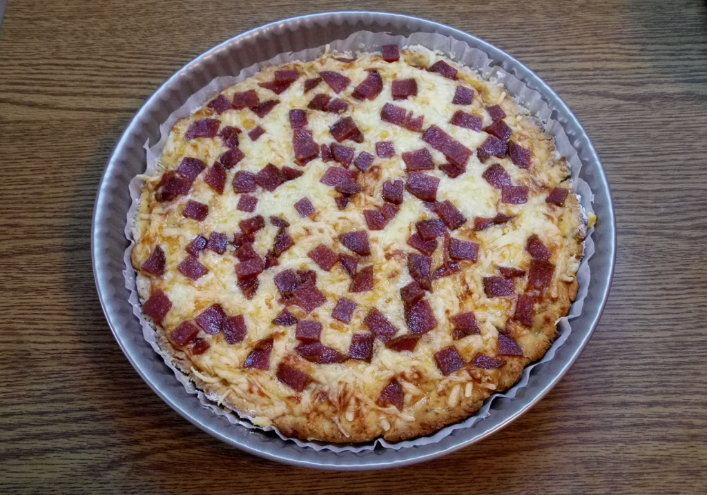 Cheesy gluten-free pepperoni pizza, right out of the oven