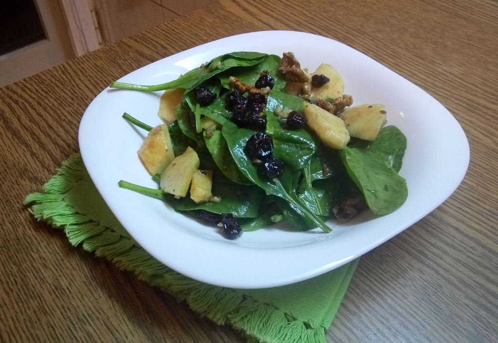Sweet and savory baby spinach apple salad, with cranberries and walnuts