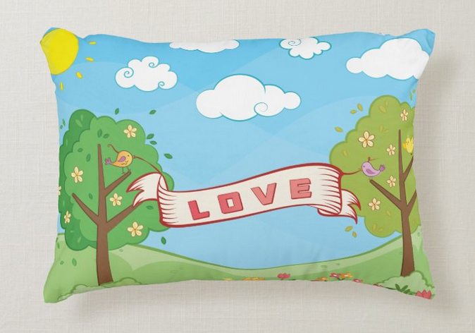 Pillow for kids with trees in summer and birds holding a large LOVE banner