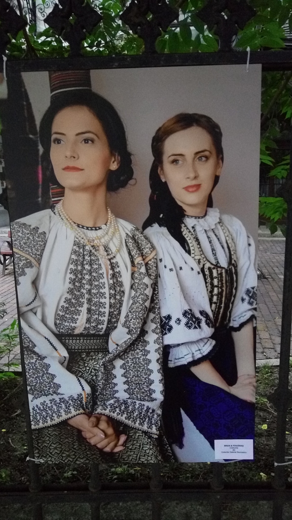 Two women dressed in traditional costumes from Bran and Fagaras, respectively, in Romania
