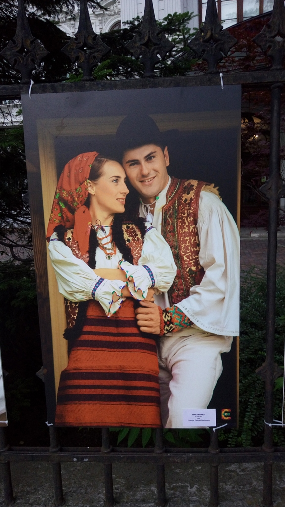Man and woman dressed in traditional costumes from Maramures, Romania