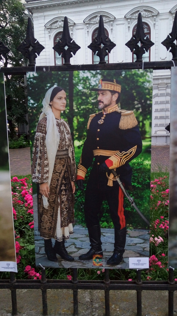 Man and woman dressed in traditional costumes from the ethnographic region of Arges, Romania