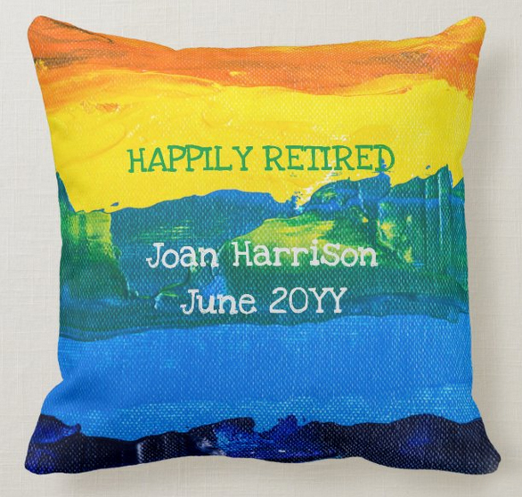 """Back of retirement cushion, sporting the text """"Happily retired"""""""