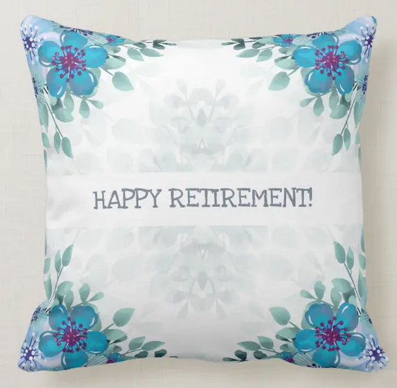 Elegant retirement pillow with blue flowers in a watercolor design